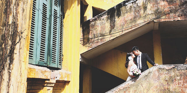 bride and groom on old building stair