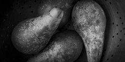 Four pears inside an utensil